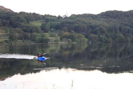 A kayaker enjoys a quet paddle right from her camping pitch Otober 2009