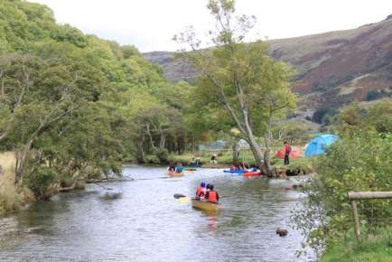 Canoes and kayaks on the river Glaslyn right next to the campsite September 2009